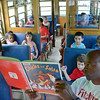 Fitchburg Police Sergeant Mark Jackson reads to local children aboard the Reading Trolley on Wednesday evening at Green Acres in Fitchburg. SENTINEL & ENTERPRISE / Ashley Green