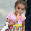 Amaya Lise, 4, enjoys a popsicle after listening to a story aboard the Fitchburg Reading Trolley on Wednesday evening at Green Acres in Fitchburg. SENTINEL & ENTERPRISE / Ashley Green