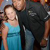 A fundraiser was held for 8-year-old Olivia Lambert at Primetime Pub in Lunenburg on Friday night. Olivia is waiting on a diagnosis of her type of autism and has been raising money to get herself a service dog. Olivia poses for a photo with Officer Randy Thomas, of the Leominster Police Department. SENTINEL & ENTERPRISE / Ashley Green