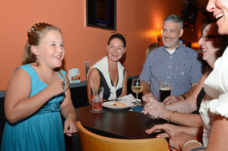 A fundraiser was held for 8-year-old Olivia Lambert at Primetime Pub in Lunenburg on Friday night. Olivia is waiting on a diagnosis of her type of autism and has been raising money to get herself a service dog. Olivia greets guests while dad Bruce and mom Debra look on. SENTINEL & ENTERPRISE / Ashley Green