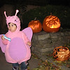 Cyane in front of our house with our jack-o-lanterns.  Yes, mommy carved those pumpkins and yes, I had a minor mishap with the carving knife.