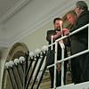 Chabad rabbi, Gov. Deval Patrick & House Speaker Bob DeLeo light the first Hanukkah candle, up on a scissors lift, on the giant Chabad menorah.