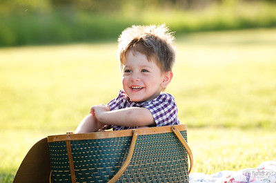 """better than a """"posed"""" picture any day....who knew all he needed was a picnic basket to climb into in order to smile? ;)"""