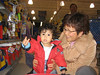 Jaden and Grandma shopping for toys.