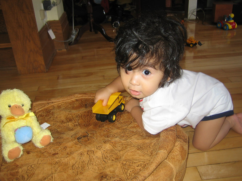 Jaden playing with his dump truck and ducky.