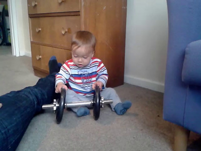 James playing with Tobias's weights 7 May 2012