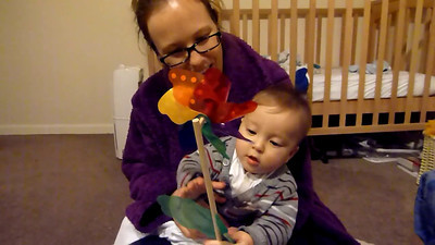 James and Steph playing with pinwheel 4 March 2012