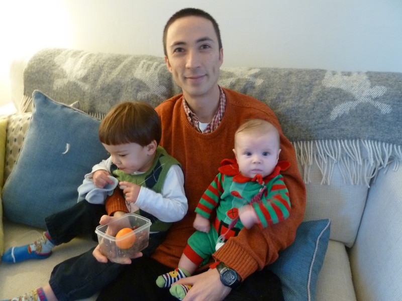 Christmas with Irene and Donal - Tobs having a cuddle with James and Quinn