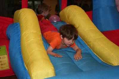 Josef on the bouncy castle slide