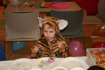 Noah decorating a cupcake