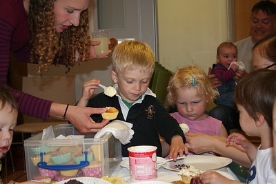 Joshua and Eva decorate more cupcakes! Neil in the background with baby Joshua.