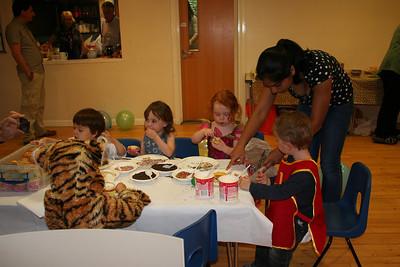 Manasa helping out at the cupcake table.
