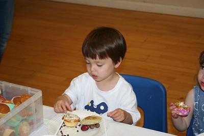 James decorating a cupcake