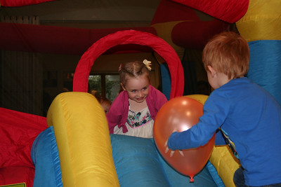 Lucy and Freddie on the bouncy castle