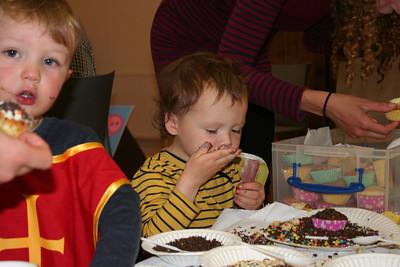 Theo enjoying lots of sprinkles on his cupcake!