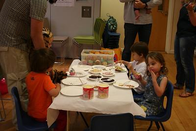 James, Amelia, Josef and Noah decorating cupcakes