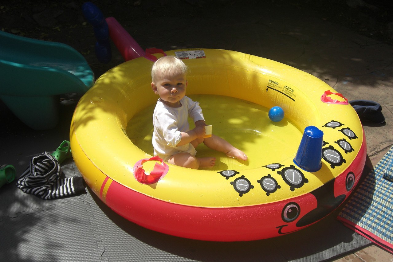 In our new backyard! It's warm enough for a plunge!