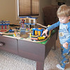 Kenny finished putting the train set together Sunday morning.  Chase really likes it!