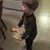 Chase is carrying Gee Gee's roaster door stop around.
