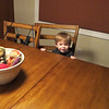 His new favorite activity - sitting at the table.