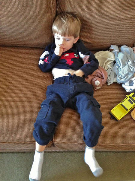 Chase is watching TV Al Bundy style.  Pop enjoyed this picture, Nana did not.