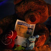 A teddy bear lit up by candles holds a missing poster for Jeremiah Oliver, 5, who has been missing since Sept. 14, 2013. SENTINEL & ENTERPRISE/JOHN LOVE