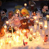 There were teddy bears and stuffed animals around candles at the memorial for Jeremiah Oliver, 5, during the candlelight vigil on Kimball Street Wednesday night in Fitchburg. Jeremiah has been missing since Sept. 14, 2013.