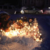 Cars pass by the memorial for Jeremiah Oliver, 5, on Kimball Street in Fitchburg Wednesday night during the candlelight vigil. SENTINEL & ENTERPRISE/JOHN LOVE