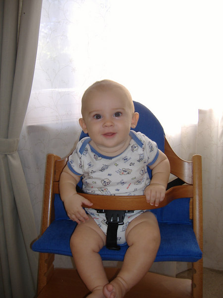 Jack ate breakfast in his high chair for the first time today. He's also sporting a bit of a suntan despite our efforts to keep him in the shade & slathered in baby sunblock!
