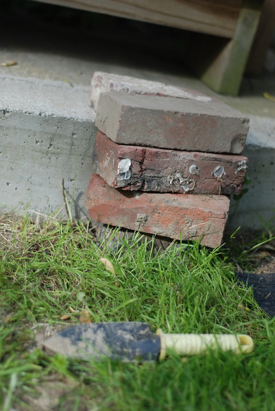 "Catherine's bit of masonry; a custom step built ""Just for Esme."""