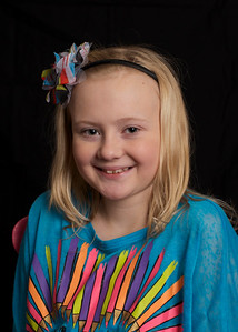 Miss L* wanted to re-do her school pictures...if you're keeping track, that's 3 beautiful girls in this family!