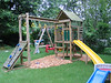 Our new swingset!! (Wood chips in progress!)