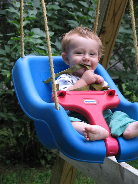 """Adrian 8 months loving his """"new"""" swing!"""