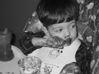 Kevin at 21 months enjoying some pudding.