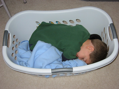Kevin(almost 3) wanted to help me with the laundry, but found it easier to take a nap instead.  He had just had a big day of Easter egg hunting at the park with some friends.