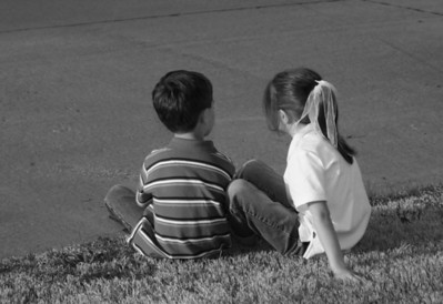 Katie and Kevin decided to sit on the curb and talk about their school day after getting off the bus.