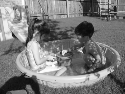 Katie and Kevin making a creation of some kind in the pool. Kevin 2 and Katie almost 5.