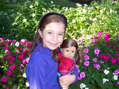"Katie 7 years old at the Dallas Arboretum proudly showing off her new ""just like me"" American Girl doll."