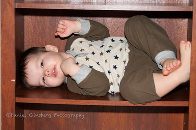 Boy in a bookshelf.