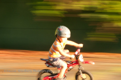 Riding a bicycle really fast.