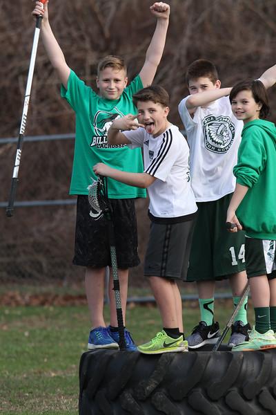 Lacrosse boys on big tire 040116