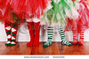 stock-photo-four-little-girls-wearing-christmas-socks-and-tutu-s-32222320