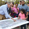 """Gene Bolinger, Vice President of Weston & Sampson's Engineers, shows off future plans at the community meeting at Lowe Playground on Elm Street in Fitchburg. The city recently received a $200,000 """"Our Common Backyards"""" grant from the state for renovations to the park. SENTINEL & ENTERPRISE / Ashley Green"""