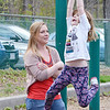 "Dawn Newman and daughter Kaylin MacGregor, 7, on the existing play structure at Lowe Playground on Elm Street in Fitchburg. The city recently received a $200,000 ""Our Common Backyards"" grant from the state for renovations to the park. SENTINEL & ENTERPRISE / Ashley Green"