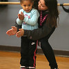 Afternoon dance party for pre-schoolers at the Greater Lowell YMCA. Arianna Welch, 4, of Lowell, teacher Kieana Melendez of Lowell, dancing. (SUN/Julia Malakie)