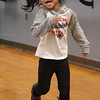 Afternoon dance party for pre-schoolers at the Greater Lowell YMCA. Vivianna Lim, 4, of Lowell, in a game of Duck-Duck-Goose. (SUN/Julia Malakie)
