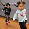 Afternoon dance party for pre-schoolers at the Greater Lowell YMCA. Arianna Welch, 4, of Lowell, is chased by Leo Ginsberg, 3, of Lowell, in a game of Duck-Duck-Goose. (SUN/Julia Malakie)