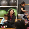 Afternoon dance party for pre-schoolers at the Greater Lowell YMCA. From left, Arianna Welch, 4, teacher Kieana Melendez, Sangely Garcia, 4, and Gabriella Bones, 4, all of Lowell, play Duck-Duck-Goose. (SUN/Julia Malakie)