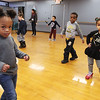 Afternoon dance party for pre-schoolers at the Greater Lowell YMCA. Zoe Rosario, 3, of Lowell, left, Princeton Kaziba, 4, of Tewksbury, center, and Nylah Nwaise, 3, of Lowell, dancing. (SUN/Julia Malakie)