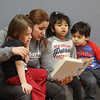 Afternoon dance party for pre-schoolers at the Greater Lowell YMCA. Reem Niyazi of Lowell reads to Zachariah Lundberg, 4, left, Vivianna Lim, 4, and Matthew Guzman, 3, all of Lowell. (SUN/Julia Malakie)